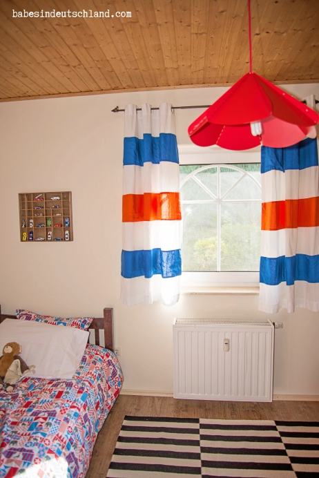 Babes in Deutschland, applique color block stripes on to plain curtains to update them