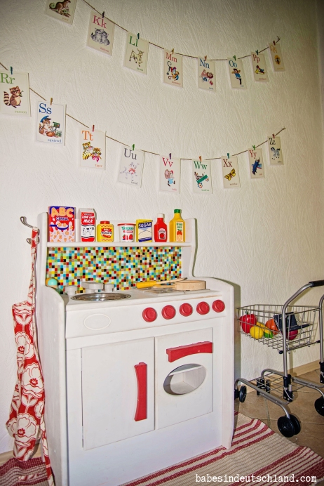 Upgrade a boring toy kitchen with paint and a mosaic backsplash!